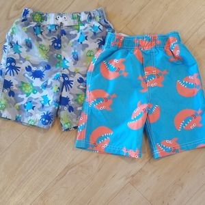 2 pairs of swim trunks (size 3T)
